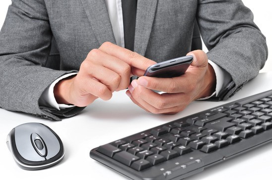 photodune-8463508-businessman-using-a-smartphone-in-the-office-xs